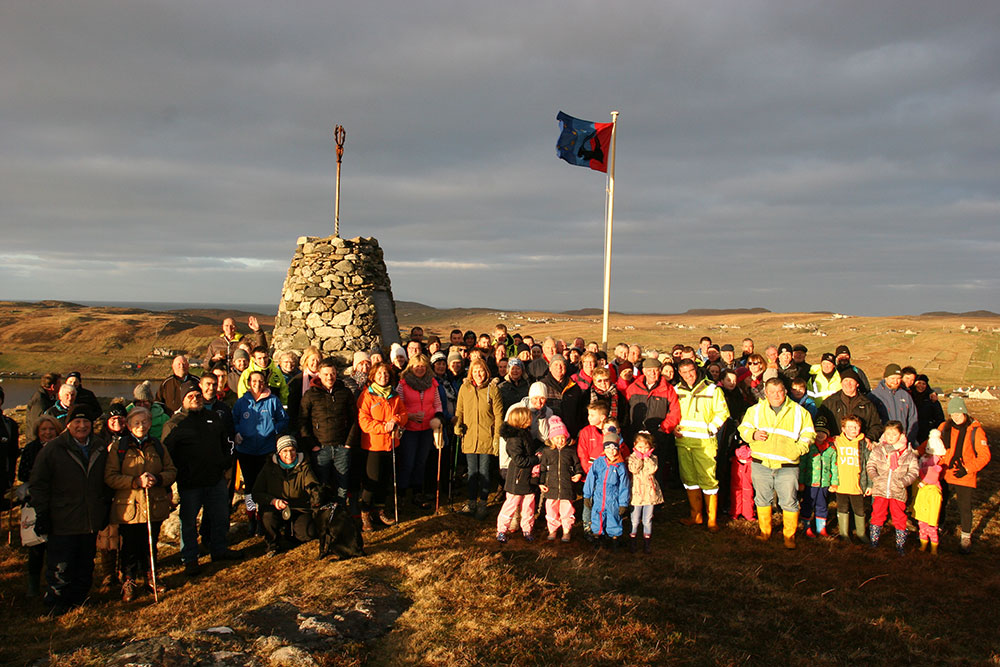 Our Carloway Community below the Carloway flag